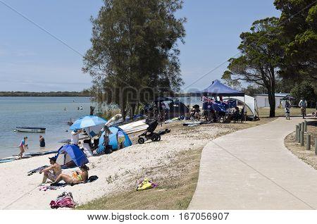 CALOUNDRA, AUSTRALIA - January 26, 2017: Celebrating Australia Day 2017 at the beach with a big Australia flag.
