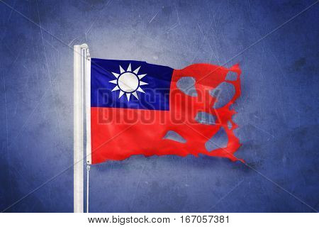 Torn flag of Taiwan flying against grunge background