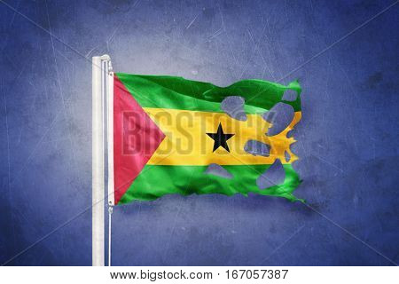 Torn flag of Sao Tome and Principe against grunge background