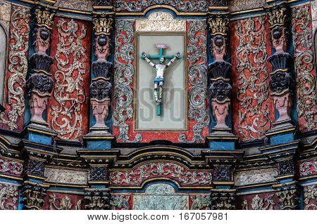 VALLADOLID MEXICO - DECEMBER 29 2016: Details of the 16th century wooden altar in the Monastery of San Bernardine of Siena.