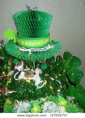 Lighted Saint Patrick's Day decorations feature green shamrocks garland carnations gold clover Irish top hat whimsical mice with blarney stone.