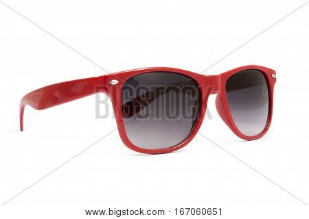 Beautiful red sunglasses isolated on white background