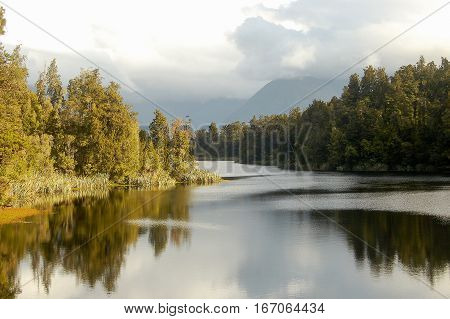 Clouds over Lake Matheson in the Glaciers Country on the South Island of New Zealand