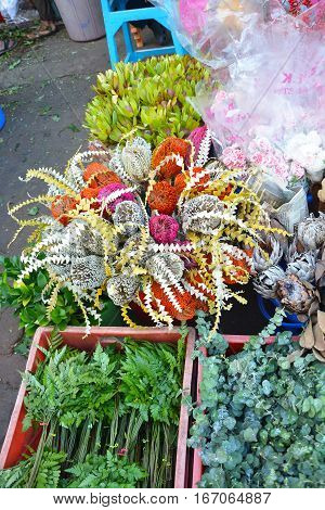 MUMBAI INDIA - JANUARY 11 2017: Flower display at the Mumbai Flower Market. The Flower Market opens at 4am and is filled with vendors offering their wares to shop owners decorators and florists.