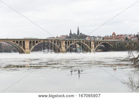 Washington DC in winter - a view from Georgetown and Key bridge in snow blizzard