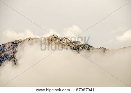 Wasatch Mountains in Utah with clouds above and fog below