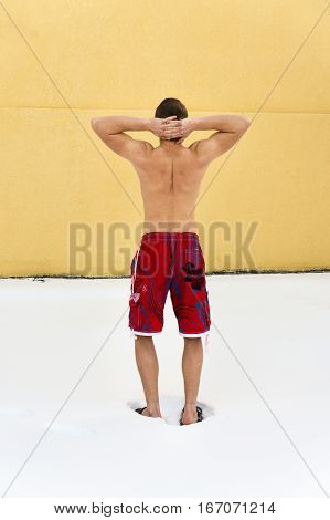 Back View Of Muscular Man Hardening In Winter.