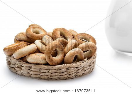 Whole bagels in a wicker basket. Sweet bread. isolated