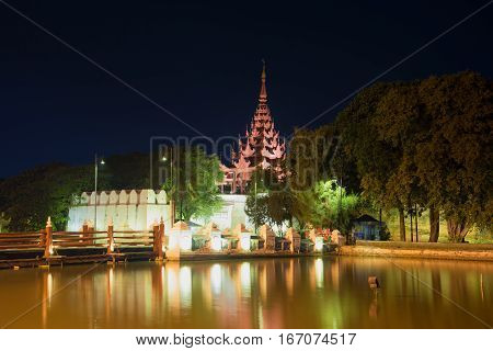 The old gate Bastion of the fortifications of the ancient city of Mandalay in the late evening. Myanmar