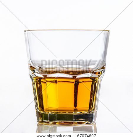 glass of whiskey or scotch on white background
