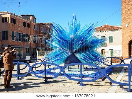 Blue Murano Glass Sculpture In A Square In Murano, Venice, Italy.