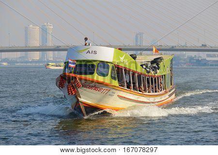 BANGKOK, THAILAND - DECEMBER 12, 2016: High-speed passenger boat on Chao Phraya river close-up