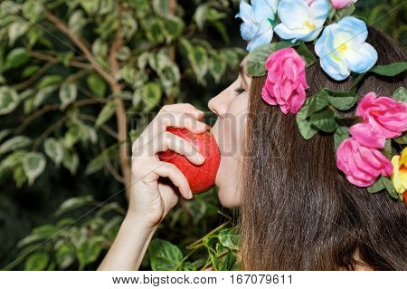 Young Girl Biting An Apple