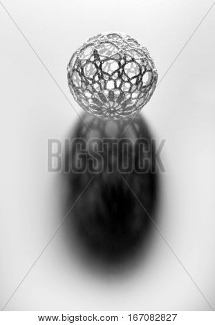 Ball With Openwork Shell Casting Shadow