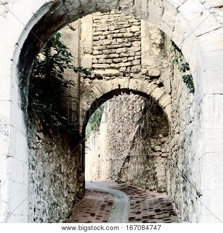 Deserted Archway in the Medieval French City Vintage Style Toned Picture