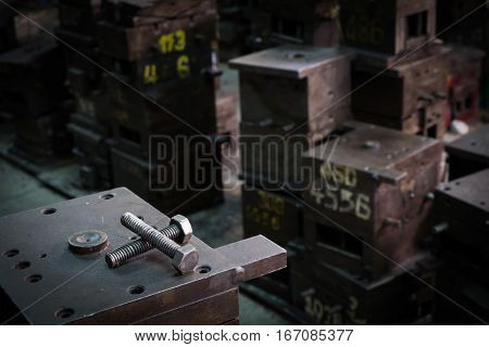 Screw bolts on old machines or molds in old factory.