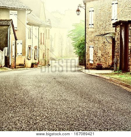 French Village Street in the Morning Mist Vintage Style Toned Picture