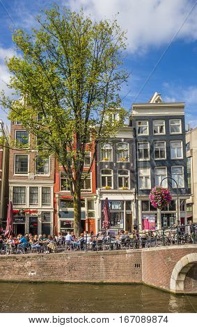 AMSTERDAM, NETHERLANDS - SEPTEMBER 18, 2016: Traditional houses at a canal in Amsterdam, The Netherlands