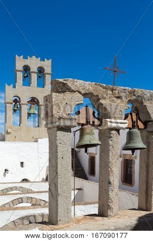 PATMOS GREECE - SEPTEMBER 24 2016: Focus on the foreground bell tower in the Monastery of St John