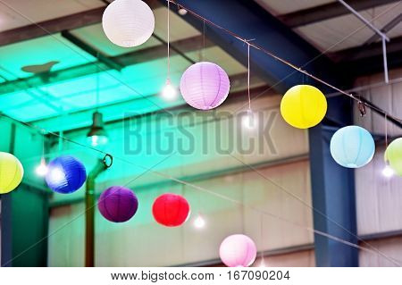 Colorful lantern lampions hanging on a ceiling during entertainment event