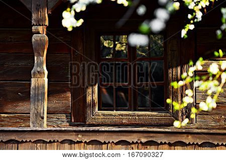 Traditional old wooden house porch detail in springtime season