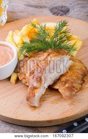 Fried chicken meat served with french fries