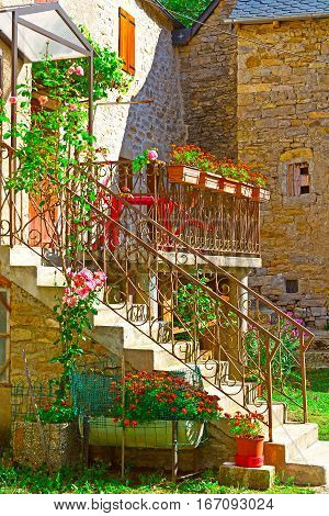 Patio of French House with Porch Decorated with Fresh Flowers