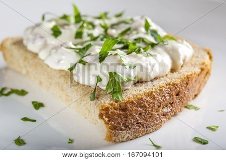 Appetizer made from horseradish sour cream and mayonnaise on a slice of bread
