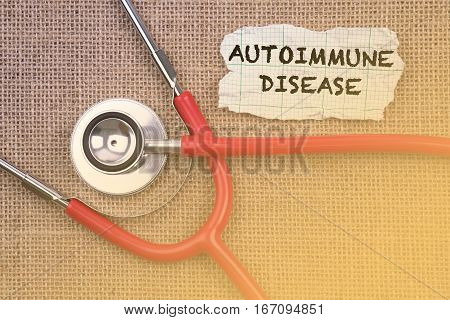 Stethoscope and paper with word autoimmune disease. Medical Concept