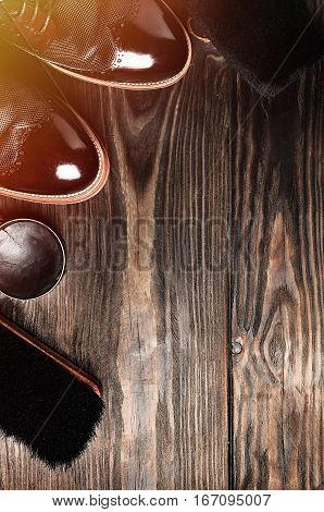 leather shoes on table with polishing equipment. Fashion shoes handmade. Wax. Wooden background