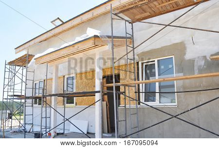 Renovation of the Rural House with Plastering, Stucco, Insulation and Painting in White Color Exterior House Wall.