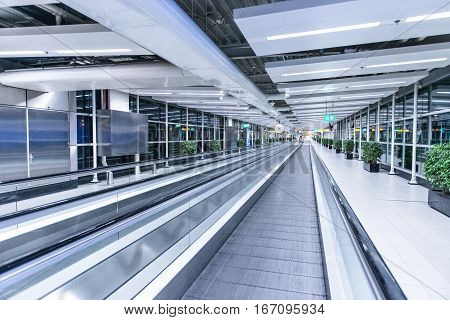 Moving waklway in the airport terminal, travel concept