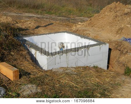 Building New Water Bore with Insulation. Installing pumping air from compressor into from new constructed water bore or well as process of cleaning and filtrating water.