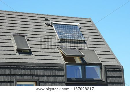 Modern House Roof with Solar Water Heater Solar Panels and Skylights Beautiful New Contemporary House with Solar Panels. Solar water panel heating.