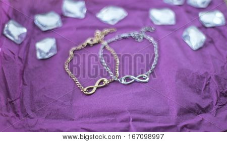 Two chains. Gold and silver chain. Beautiful chain on a pink background