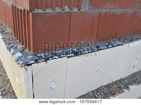 Exterior Foundation Insulation with Styrofoam Sheet Insulation. House Energy Saving.