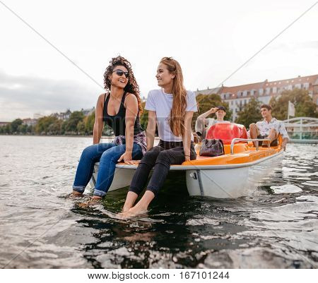 Group Of Young People On A Pedalo Boat