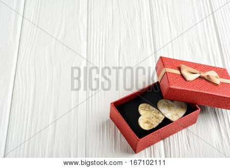 Gift by St. Valentine's Day in a red box on a white background. Copy space