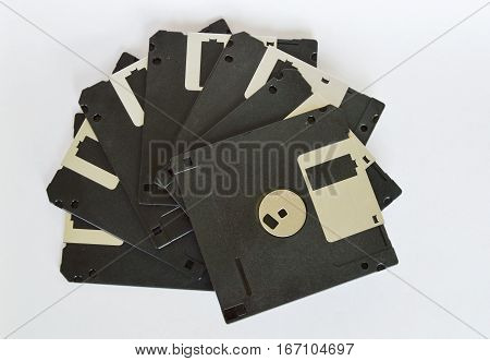 black diskette arranged on the white background