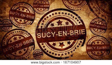 sucy-en-brie, vintage stamp on paper background