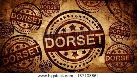 Dorset, vintage stamp on paper background