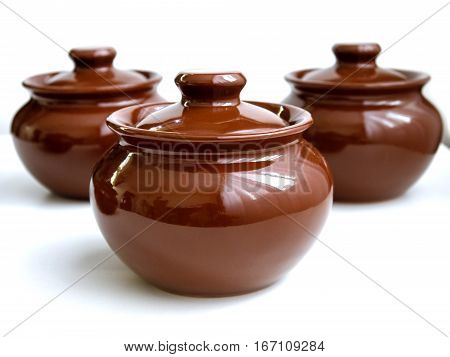clay pot for cooking isolated on white background