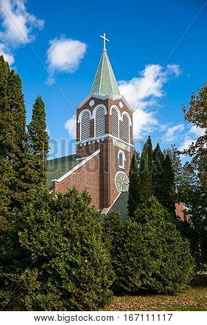 A church steeple surrounded by trees in Wisconsin