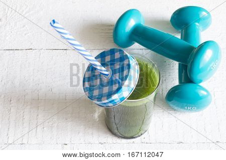 Green smoothie detox and fitness gym health care concept