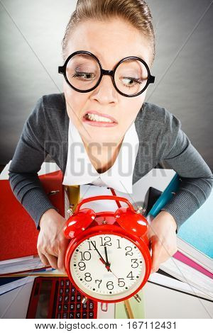 Businesswoman In Office With Big Red Clock.