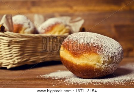 Traditional donuts sprinkled with powdered sugar. Selective focus.