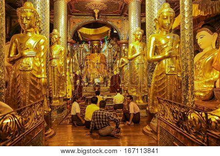 YANGON, MYANMAR -NOVEMBER 25, 2016 : people praying at Shwedagon Pagoda Yangon in Myanmar