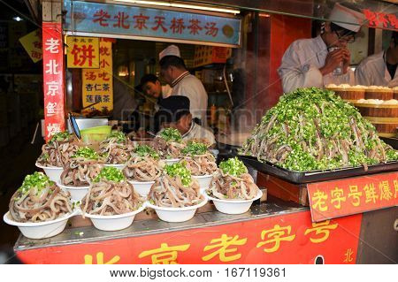 BEIJING, CHINA - NOVEMBER, 2016: One vendor offers bowls of tripe at his street food stall off Wangfujing Street