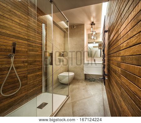 Beautiful modern bathroom in brown white,natural wood