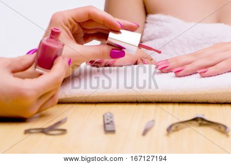 Woman hands during manicure procedure